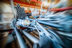 Various mechanisms and gray metal pipe. Industrial Warehouse. Various mechanisms and gray metal pipe. Toning the image. Motion blur effect Stock Photos