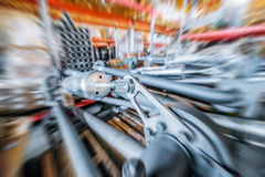 Various mechanisms and gray metal pipe. Industrial Warehouse. Various mechanisms and gray metal pipe. Toning the image. Motion blur effect Royalty Free Stock Images