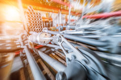 Various mechanisms and gray metal pipe. Industrial Warehouse. Various mechanisms and gray metal pipe. Toning the image. Motion blur effect. Bright sunlight Royalty Free Stock Images