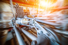 Various mechanisms and gray metal pipe. Industrial Warehouse. Various mechanisms and gray metal pipe. Toning the image. Motion blur effect. Bright sunlight Royalty Free Stock Photos