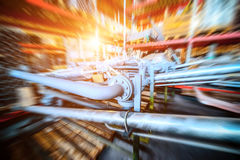 Various mechanisms and gray metal pipe. Industrial Warehouse. Various mechanisms and gray metal pipe. Toning the image. Motion blur effect. Bright sunlight Stock Photo