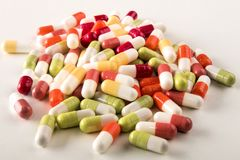 Various medical capsules on a light background royalty free stock photo
