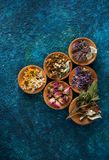 Various medical herbs and flowers. In bowls royalty free stock photos