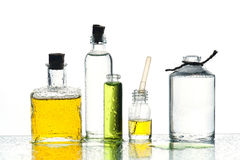 Various medicine or cosmetic bottles with color liquid Royalty Free Stock Images