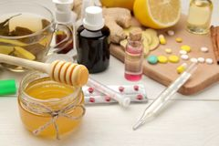 Various medicines for flu and cold remedies on a white wooden table .. Cold. diseases. cold. flu stock photo