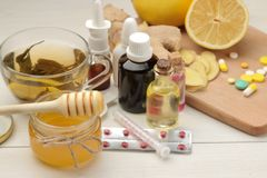 Various medicines for flu and cold remedies on a white wooden table .. Cold. diseases. cold. flu. Various medicines for flu and cold remedies on a white wooden stock photography