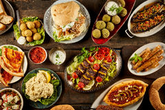 Various Mediterranean dishes and bread on table Royalty Free Stock Image