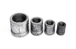 Various metal fittings inner, for pipes on white Stock Photos