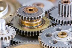 Various metal gear cogwheels for machinery, macro Stock Photography