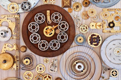 Various metal parts on wooden background Royalty Free Stock Images