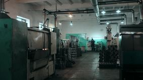 Various metal working machines in works shop stock video