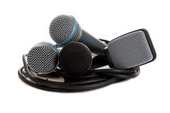 Various microphones on a white backgrounf. Four different microphones on a white background stock photography