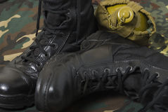 Various military thing. Military items army boots and other thing of khaki color Stock Images