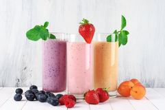 Various milkshakes with fruits stock image
