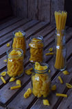 Various mix of macaroni on wooden rustic background. Assortment different kinds of Italian pasta. Diet and food concept. Spaghetti Royalty Free Stock Photography