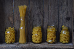 Various mix of macaroni on wooden rustic background. Assortment different kinds of Italian pasta. Diet and food concept. Spaghetti Royalty Free Stock Photo