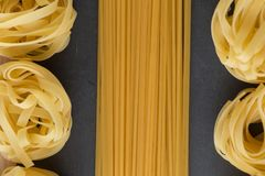 Various mix of pasta raw closeup background. Delicious dry uncooked ingredient for traditional Italian cuisine dish Royalty Free Stock Images