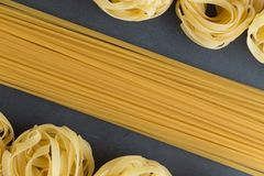 Various mix of pasta raw closeup background. Delicious dry uncooked ingredient for traditional Italian cuisine dish Royalty Free Stock Photo
