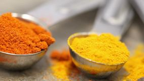Various mixed spices oregano, curcuma, paprika, anise in metal scoops on wooden table stock video