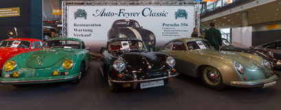 Various modifications of the sports car Porsche 356 stand in a row. Stock Images