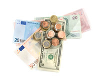 Various money currencies. Over white background, high angle shot, useful for  financial and economy themes Stock Images