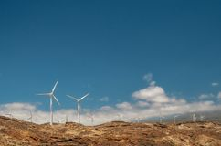 Various mountain wind turbine with blue sky. Various mountain wind turbine power with blue sky and clouds, Spain Royalty Free Stock Photo