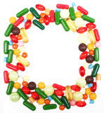 Various multicolor pills and capsules Stock Photos