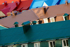 Various multicolored roofs. Row of many multicolored roofs. Top view Stock Image