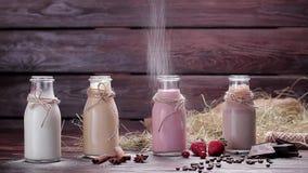 Various natural milkshakes. Various natural milkshakes sprinkled with powdered sugar. Beautiful interer stock video