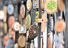 Various necklaces at souvenir market in Romania, close up. Traditional cultural neck-lets Royalty Free Stock Photography
