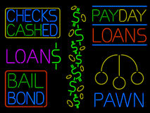 Various neon cash signs. Neon signs for various loan and cash businesses Royalty Free Stock Photography