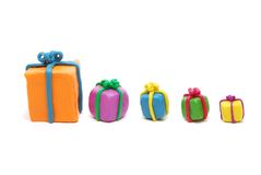 Various New Year Gifts in Row Stock Images