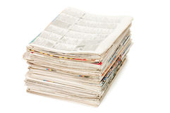 Various newspapers over white Stock Photo