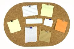 Various note papers on cork board Royalty Free Stock Photography