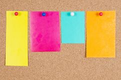Various note papers on corkboard Stock Image
