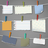 Various notes and a clothes pegs Royalty Free Stock Images