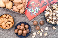 Various nut combinations on plates royalty free stock images