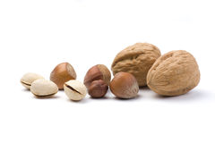 Various nuts. Collection isolated on a white background. Walnut, Hazelnut and Pistachio stock images