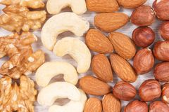 Various nuts and almonds containing healthy natural vitamins and minerals. Nutritious eating concept stock images