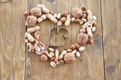 Various nuts arranged in a heart shape Stock Photo