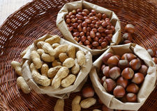Various nuts in bags Royalty Free Stock Images