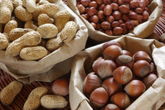 Various nuts in bags Royalty Free Stock Photos