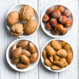 Various nuts in ceramic bowls Royalty Free Stock Photos