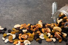 Various nuts in glass jar on dark background.  Healthy food. royalty free stock photos
