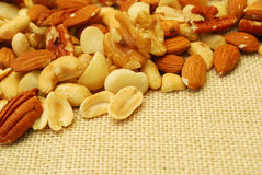 Various nuts on hessian Stock Photography