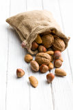 Various nuts in jute bag Royalty Free Stock Photo