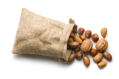 Various nuts in jute bag Royalty Free Stock Photos