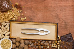 Various nuts with nut tongs Royalty Free Stock Image