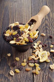 Various nuts and raisins in bowl Stock Image