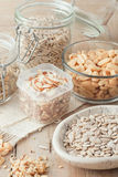 Various nuts and seeds on wooden background Royalty Free Stock Images